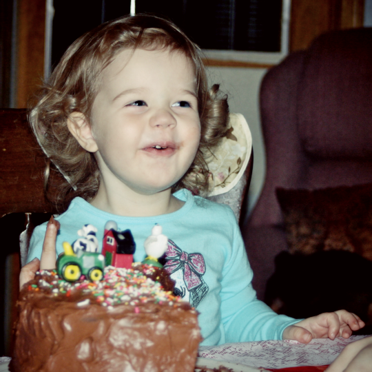 Chocolate cake for her second birthday. Look at that joy.