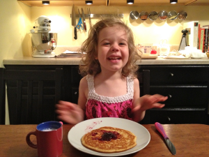 After an epic nap, Scarlett eats a pancake dinner at 9 PM. They were gourmet; it said so on the box.